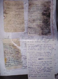 The notes left at the cairn by various walkers. Warren Bonython's from 1968 top left