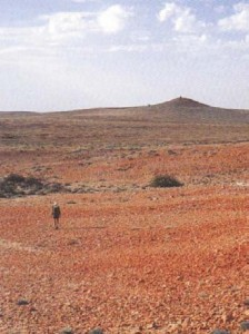 Warren Bonython walks towards the summit of Mt Hopeless at the end of his epic walk in 1968. Photo from 'Walking the Flinders Ranges', by C Warren Bonython